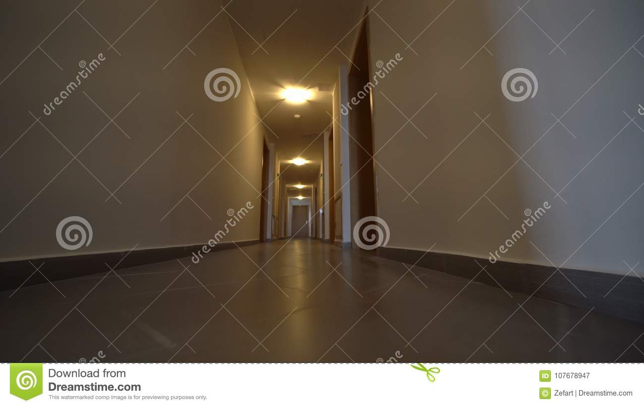 Moving camera, walk in Hotel corridor, point of view. POV. Walking through  hotel corridor. Interior gimbal shot. First person view