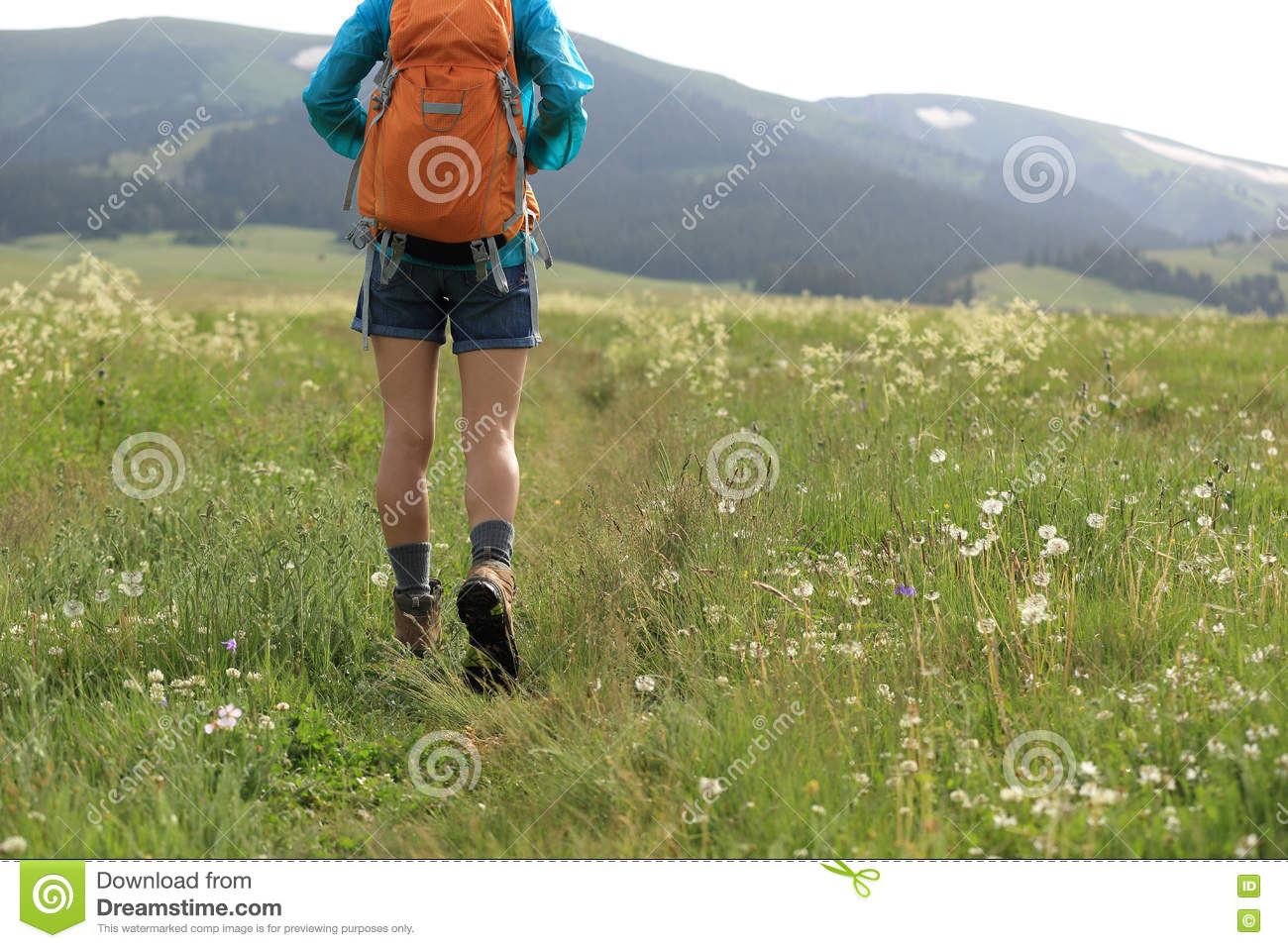 walking on trail in grassland