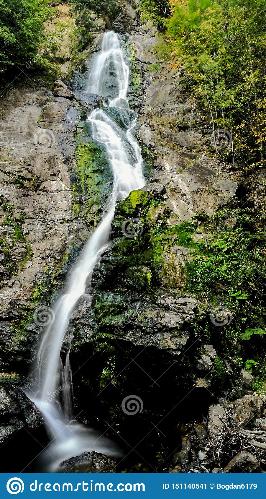 Walking through a wonderful mountain forest, I discovered a gorgeous waterfall falling from a considerable height of 20 m