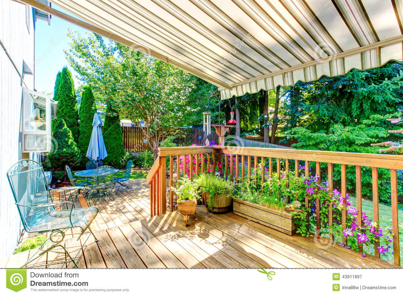 Walkout Deck With Patio Table And Umbrella Stock Photo