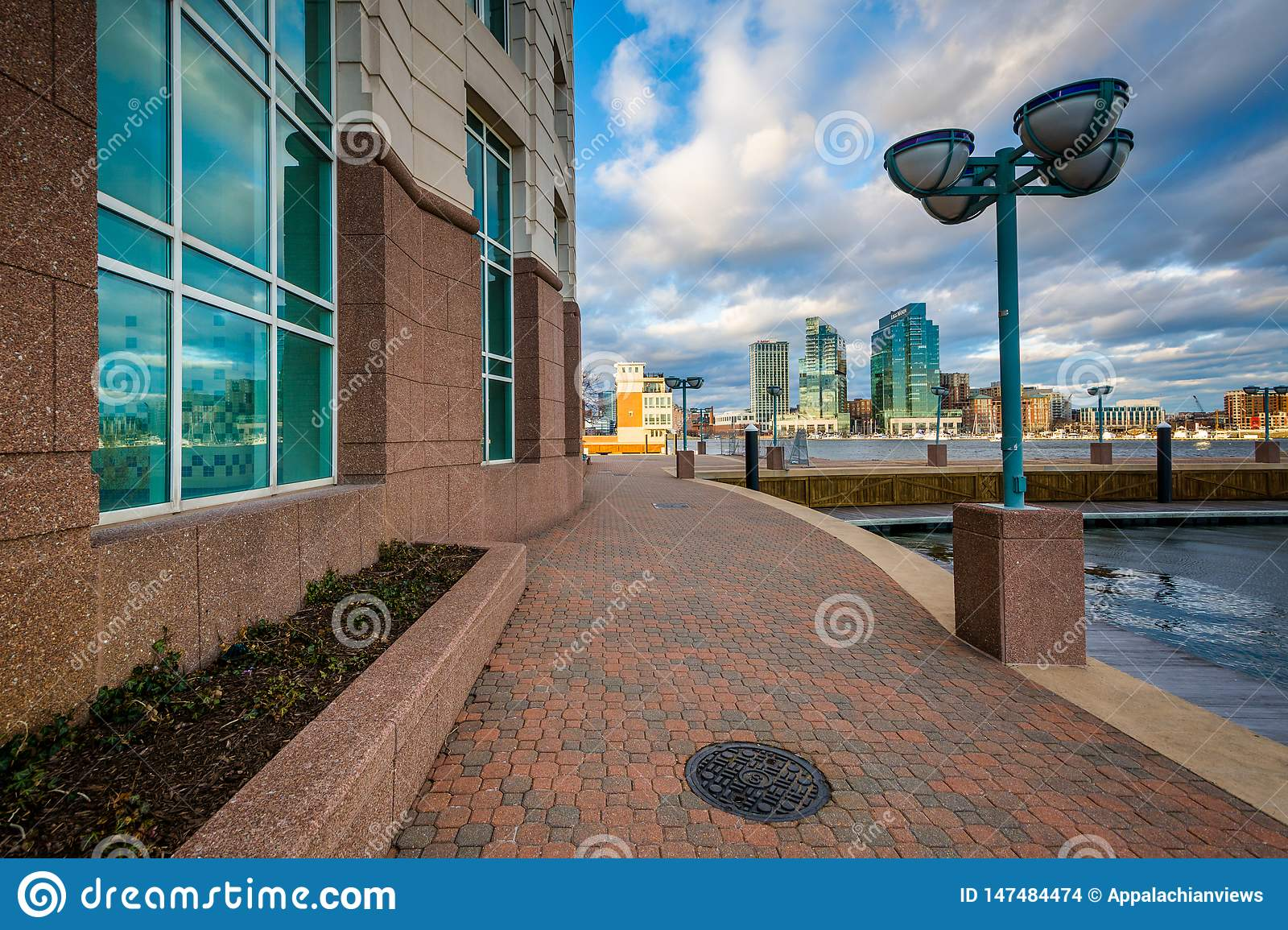 Walkway and the Harborview Tower, in Baltimore, Maryland