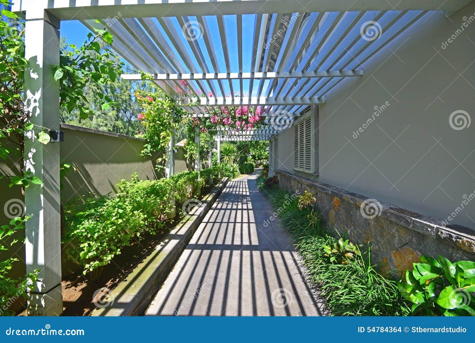 Walkway with veranda like semi open wooden rooftop stock for Open veranda design