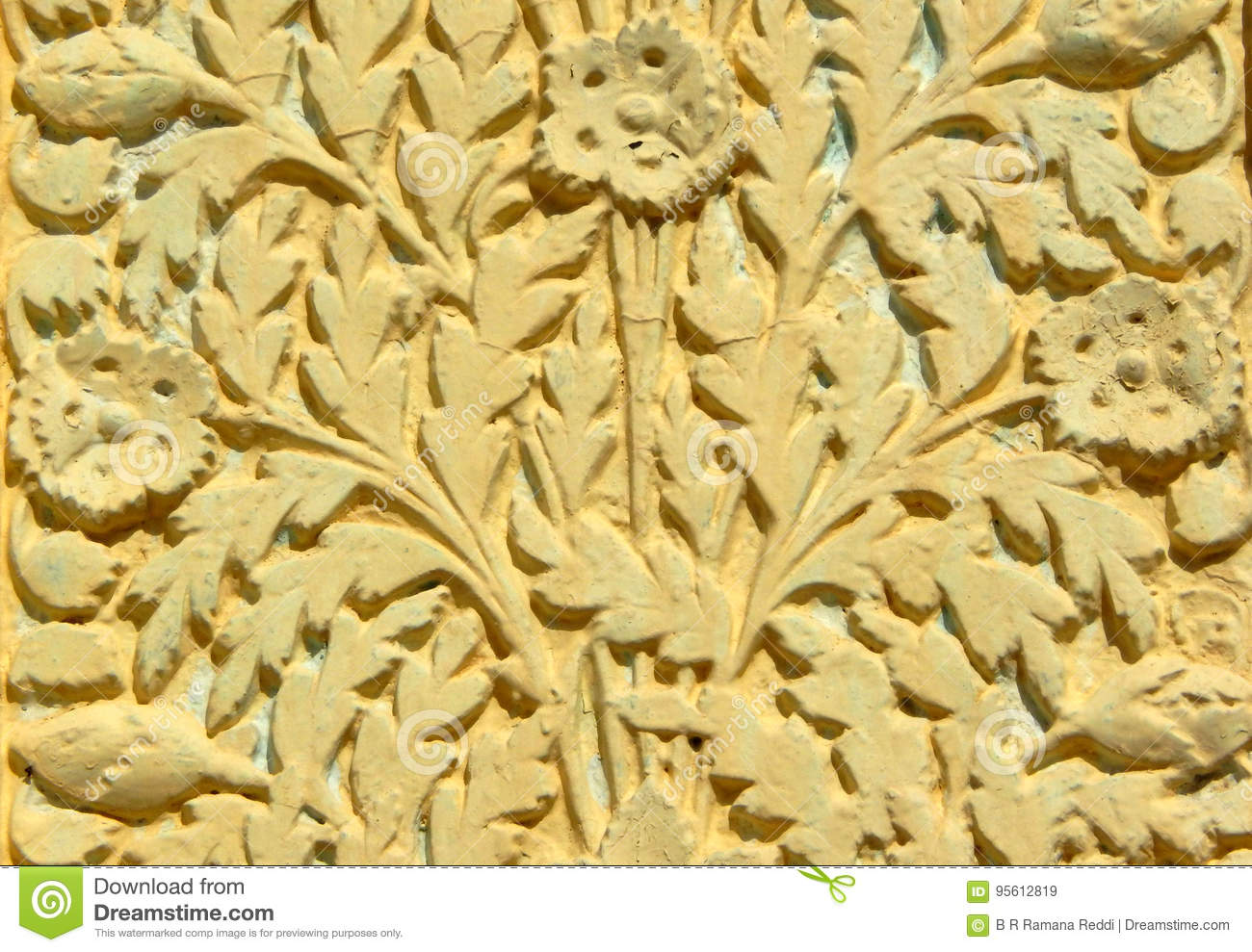 Wall art stucco work of floral designs on exteriors of 200 year old temple