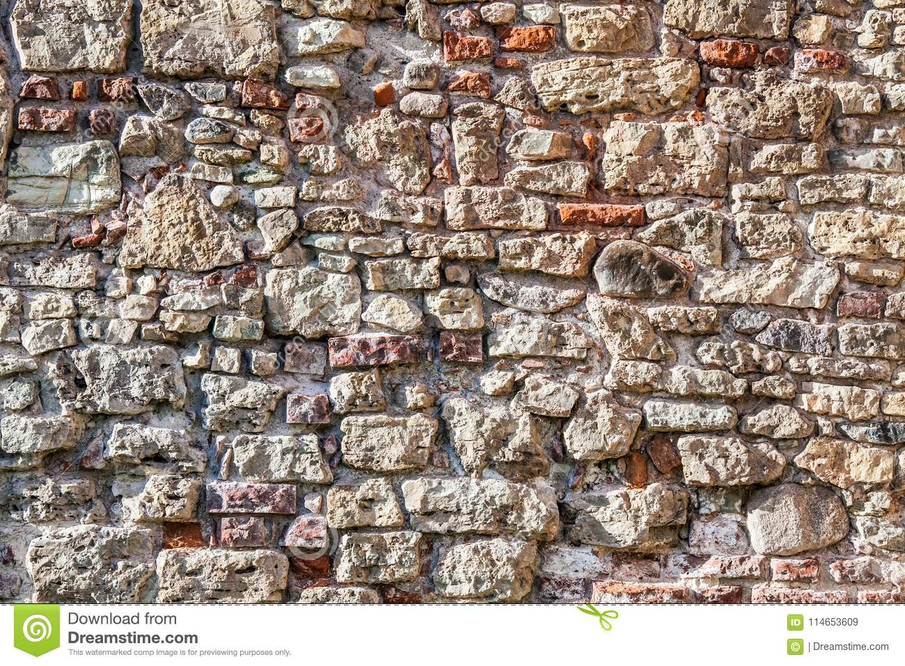 Wall of big stones and broken bricks