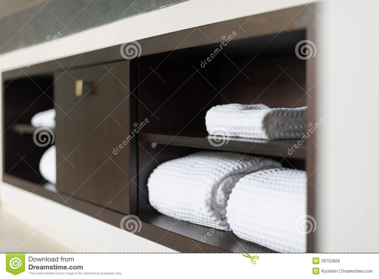 Rolled White Towels On Shelf In Hotel Bathroom Stock