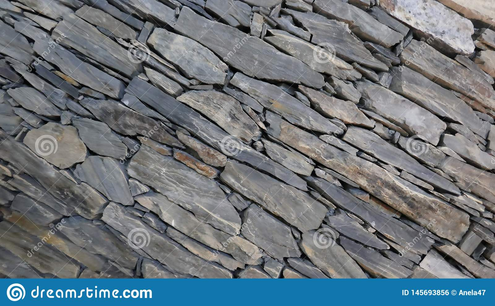 Wall of carefully stacked nature stone pieces.