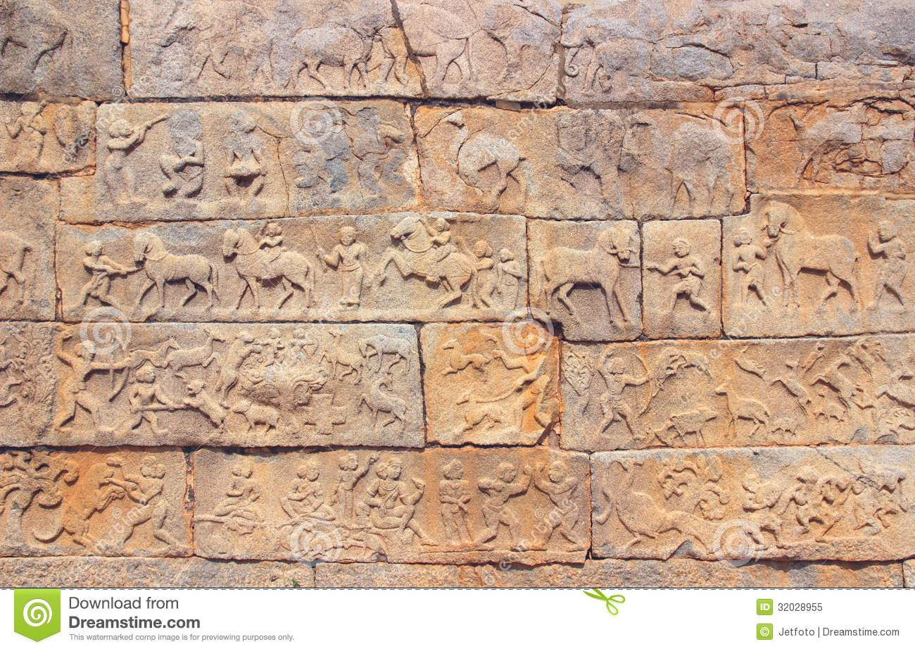 Wall with a carved relief scenes of hunting and life