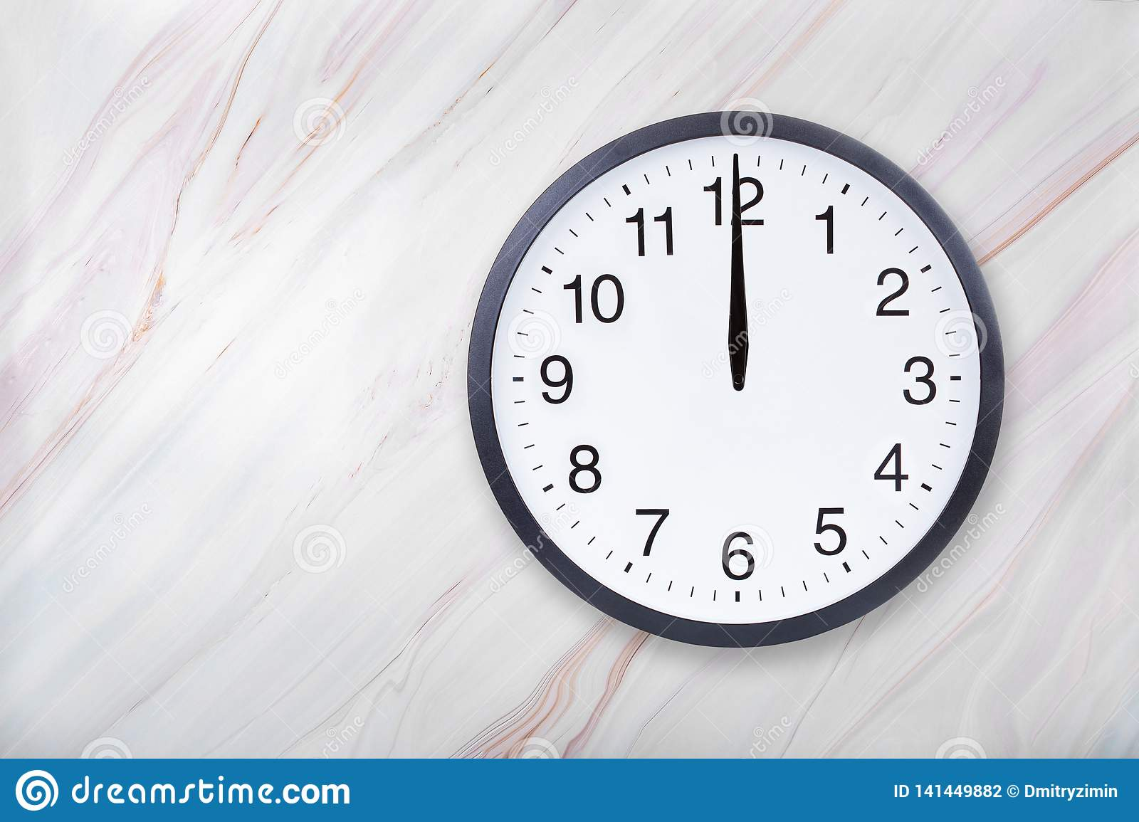 Wall clock on marble texture show twelve o`clock. Office clock show midday or midnight
