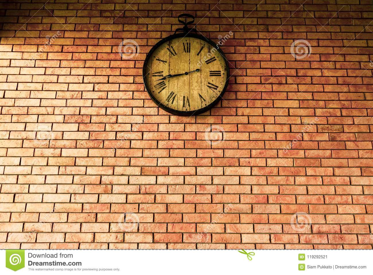 Wall Clock vintage retro styles hanging on the brick wall.