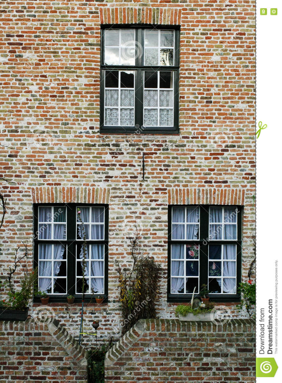 Wall Of House From Red Brick With Three Windows Stock