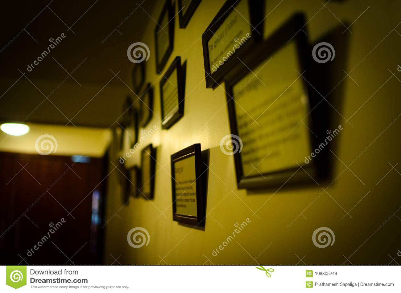 Wall With Many Frames Hanging On It Stock Image - Image of ...
