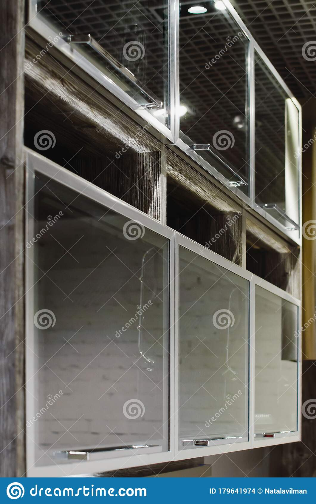 Wall Mounted Kitchen Cabinets With Glass Doors Closeup Selective Focus Modern Fashionable Furniture Stock Photo Image Of Detail Close 179641974