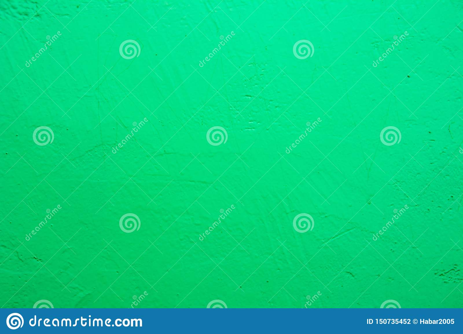 Wall painted in blue texture. Seamless texture of a light pale green concrete wall.