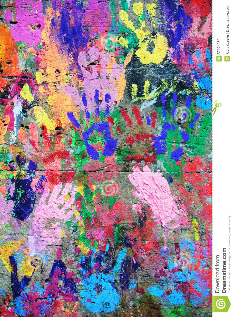 wall painted colorful background with printed hands stock photo