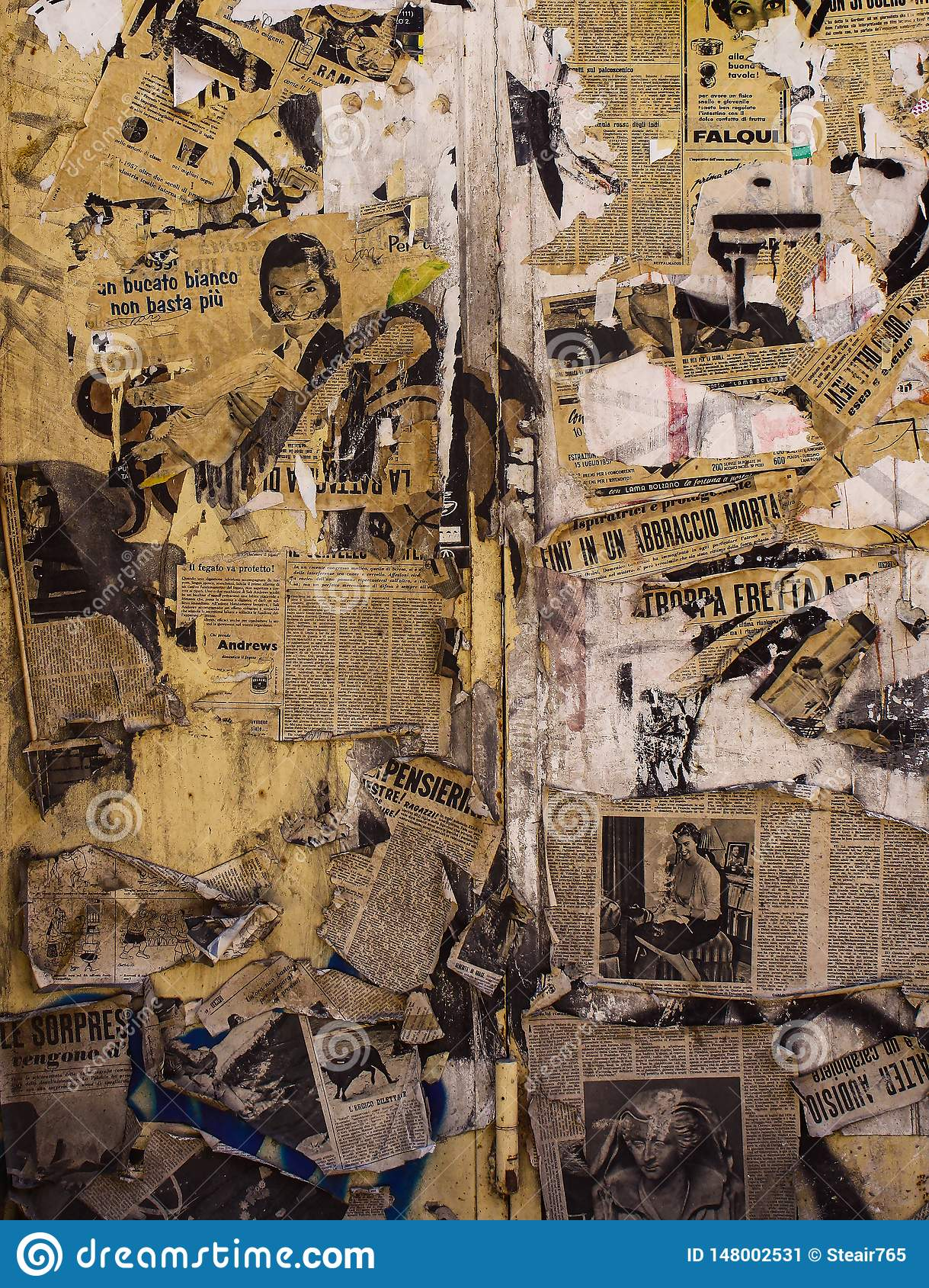 Wall papered with torn and old newspapers
