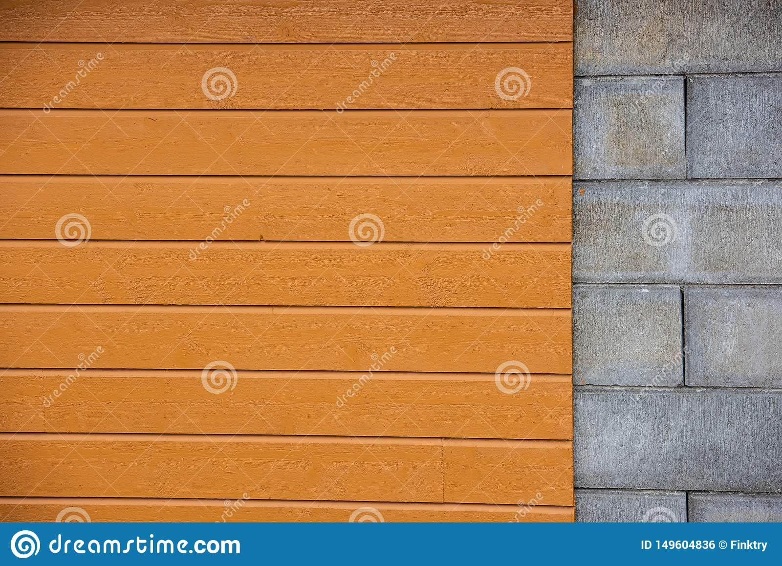 Wall with part cement blocks, part yellow wood panelling