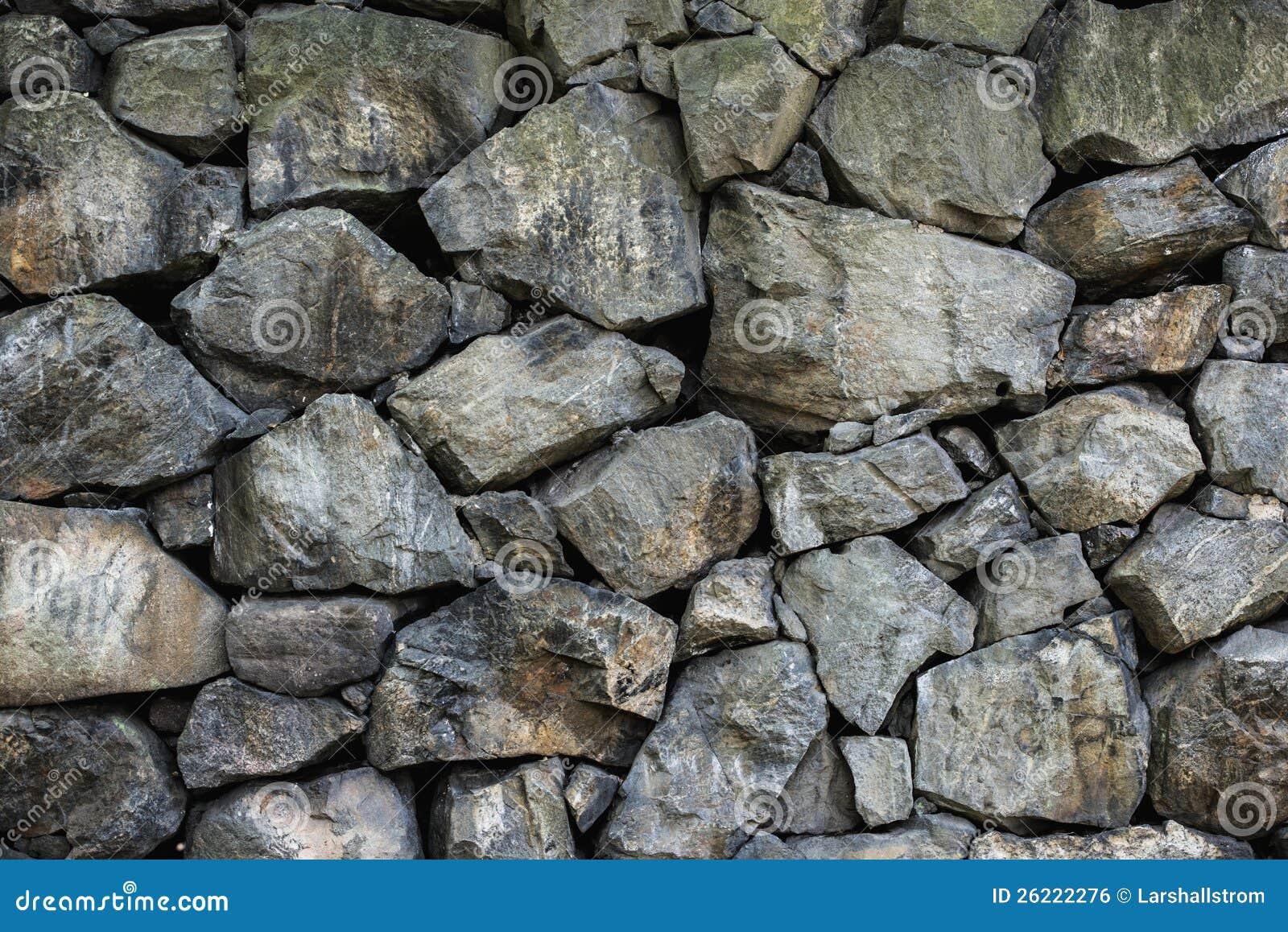 Rough Granite Block : Wall of rough stone blocks stock photo image built