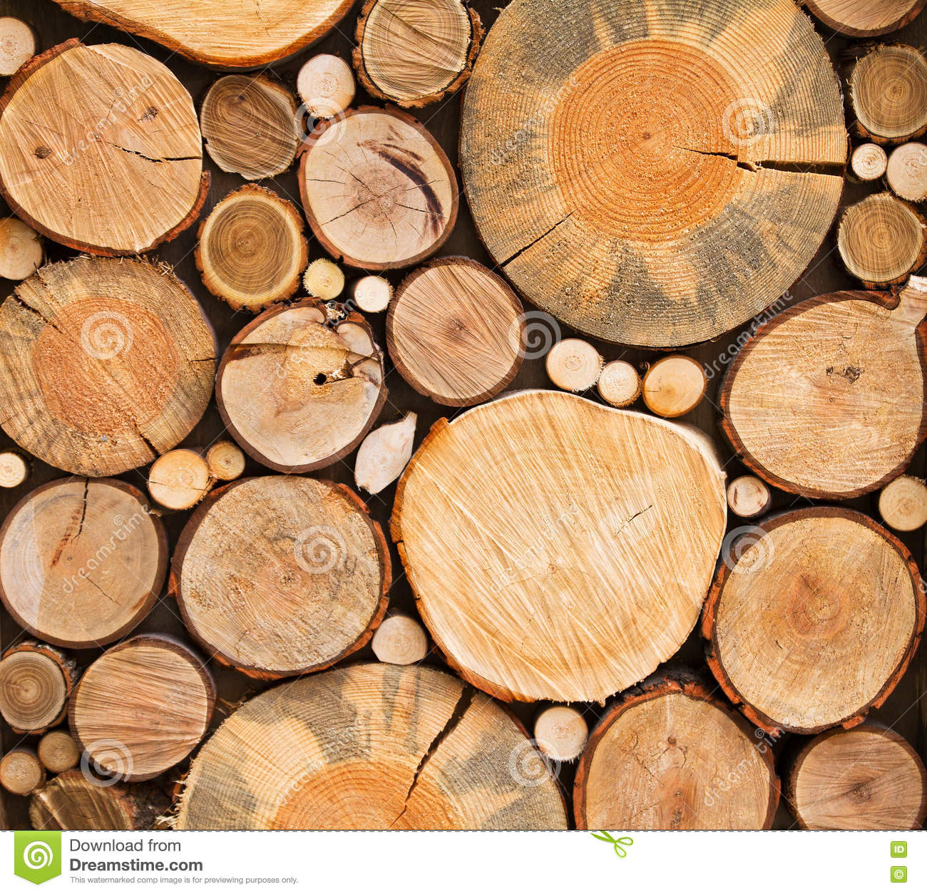 Wall of stacked wood logs as background texture stock