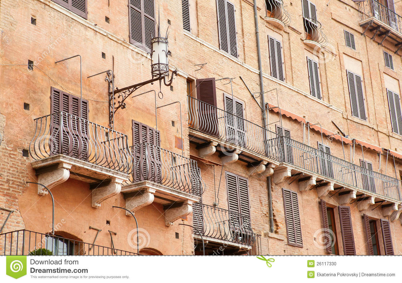 Wall with traditional balconies in sienna stock photo for Traditional balconies
