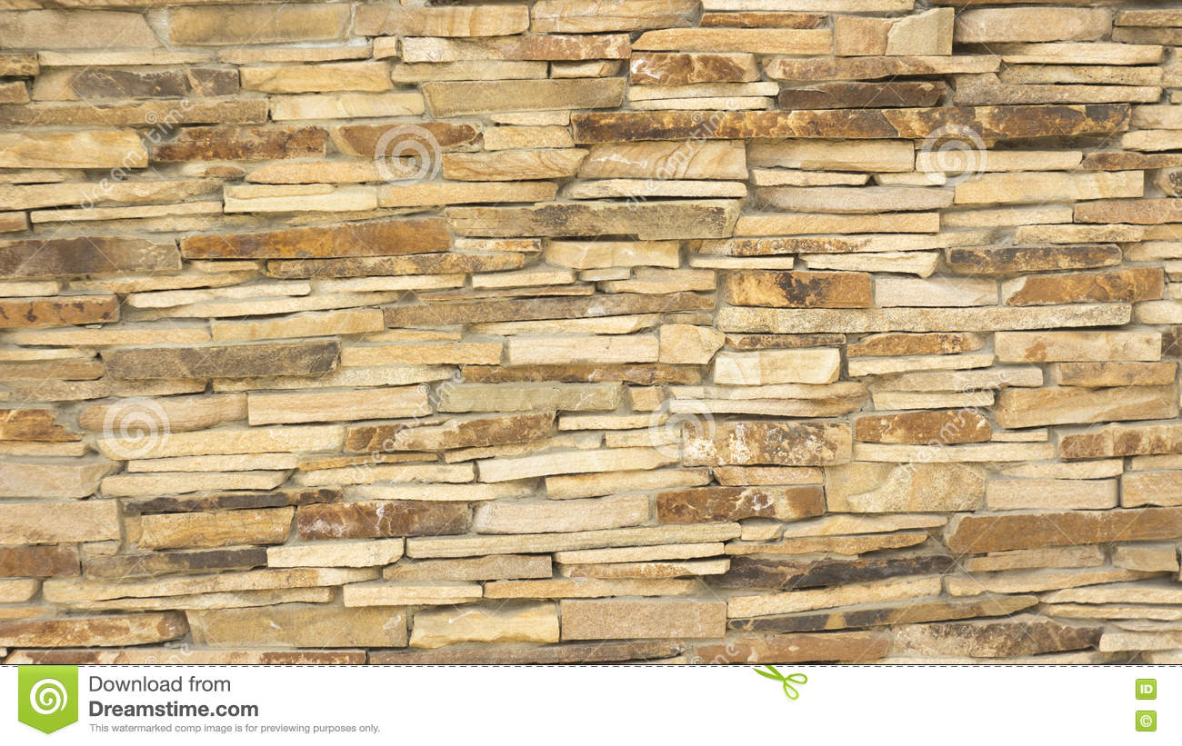 A Wall Of A Wild Yellow Decorative Stone Stock Image - Image of ...