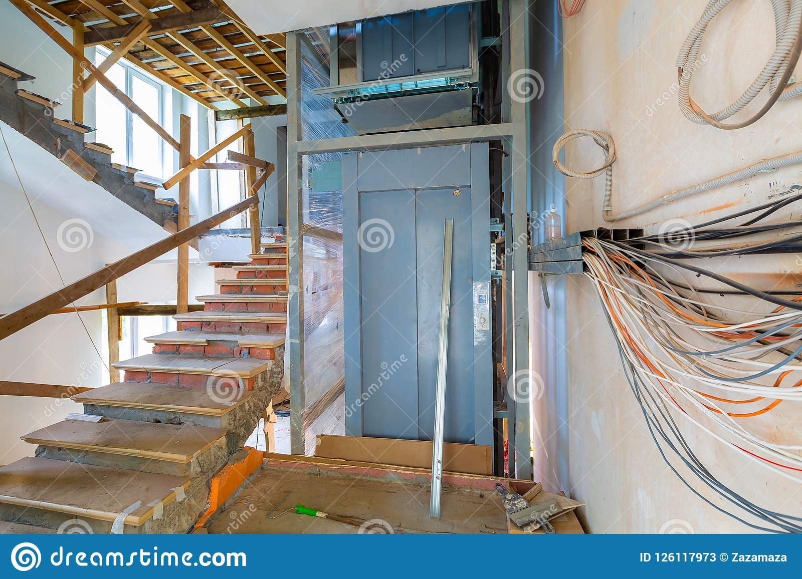 Wall With Wires, Stairs With Temporary Wooden Railing And Elevator