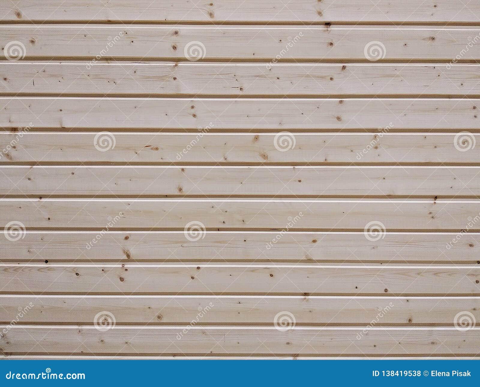 Wall of wooden beams, texture close-up