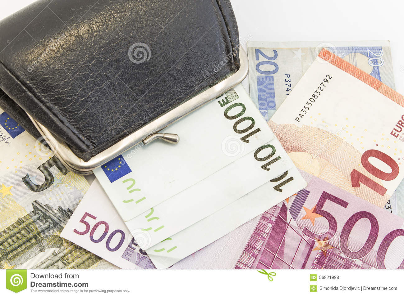 Wallet with money on white