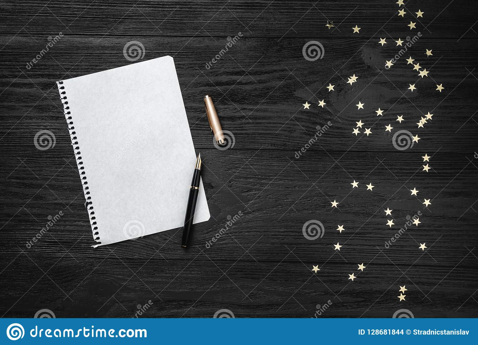 Wallpaper of winter holidays on black background. Letter for Santa Claus. Space for text. Top view