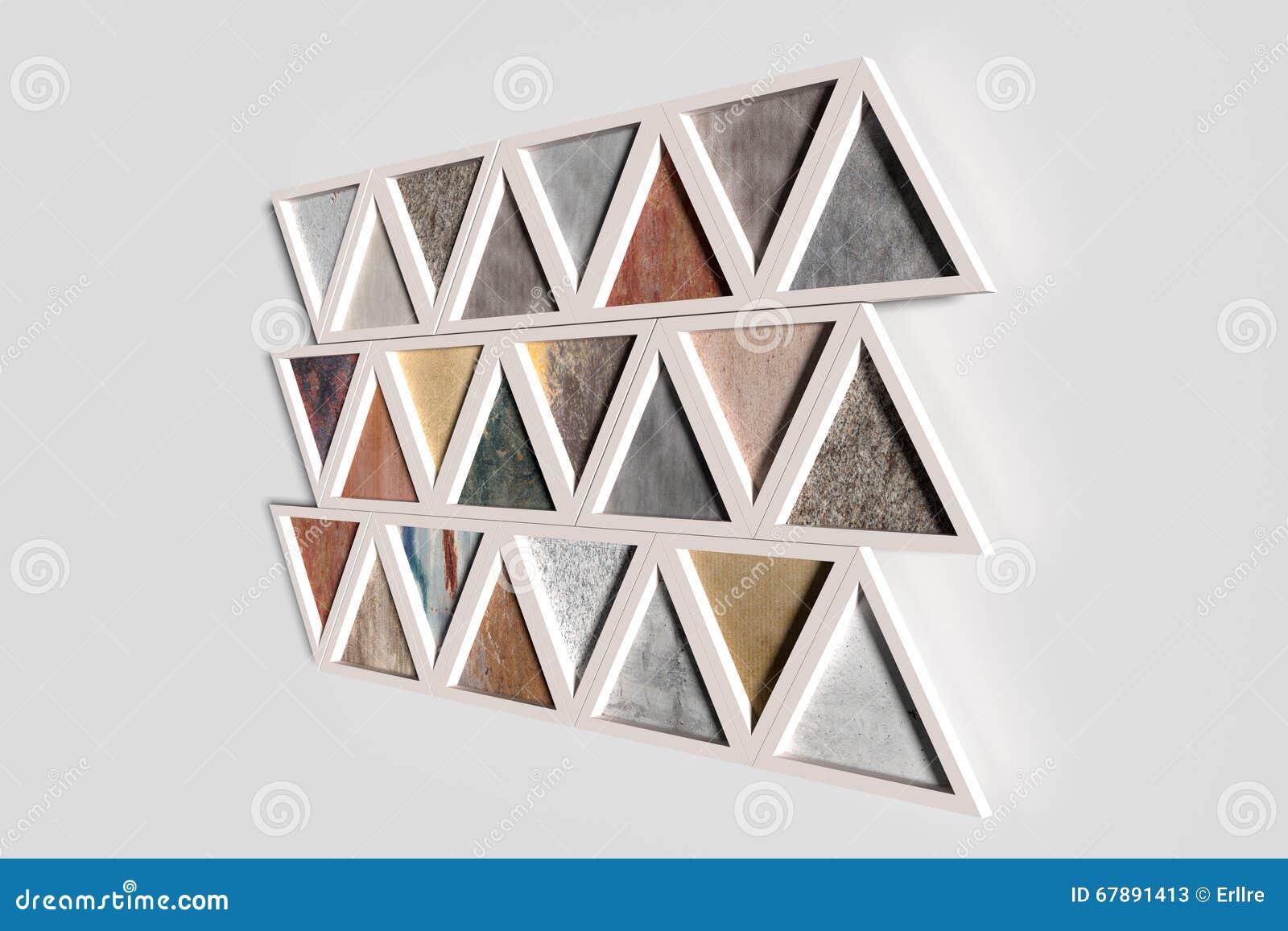 Wand mit Dreiecken von verschiedenen Materialien in den weißen Rahmen