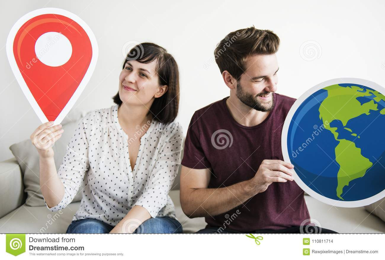 A wanderlust white couple holding icons