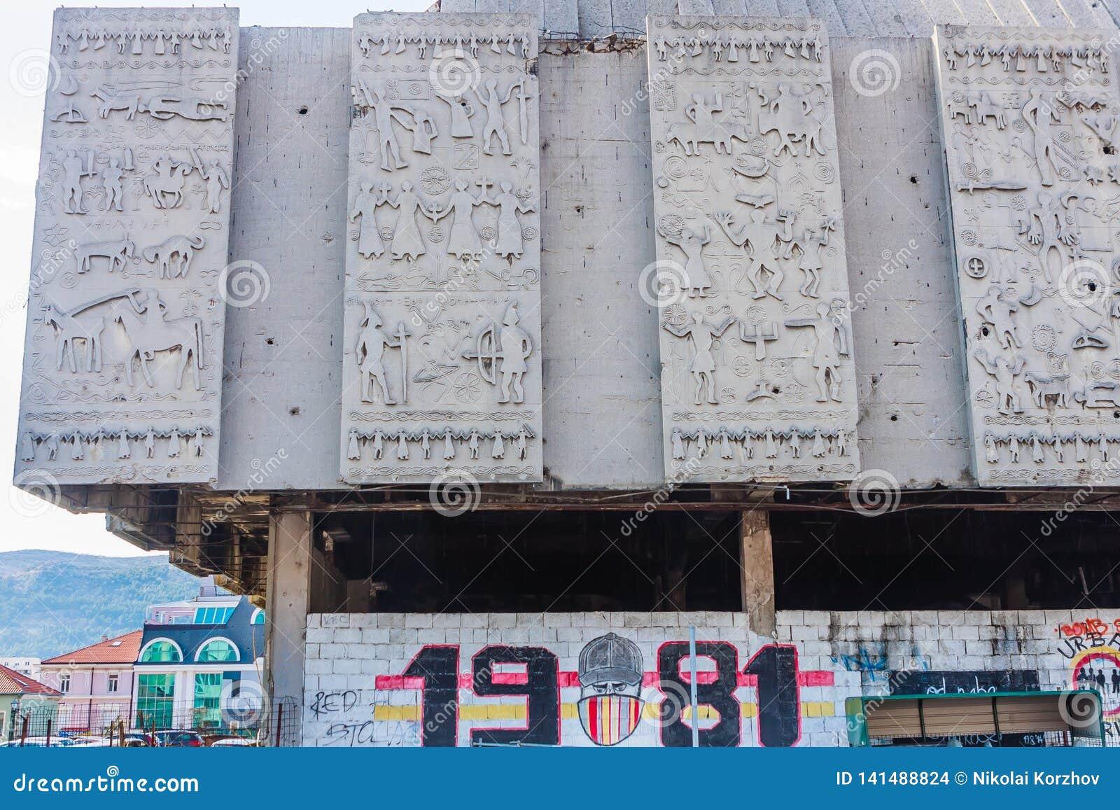 War damaged and abandoned building along Mostarski Bataljon street central Mostar city. Bosnia and Herzegovina