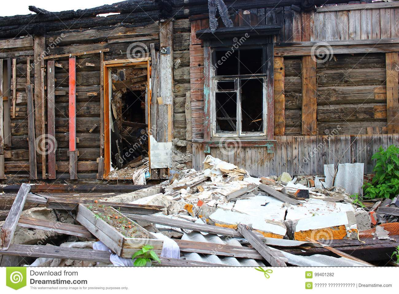 War Destroyed  Burned Down Wooden House  Charred Walls  Stock Photo