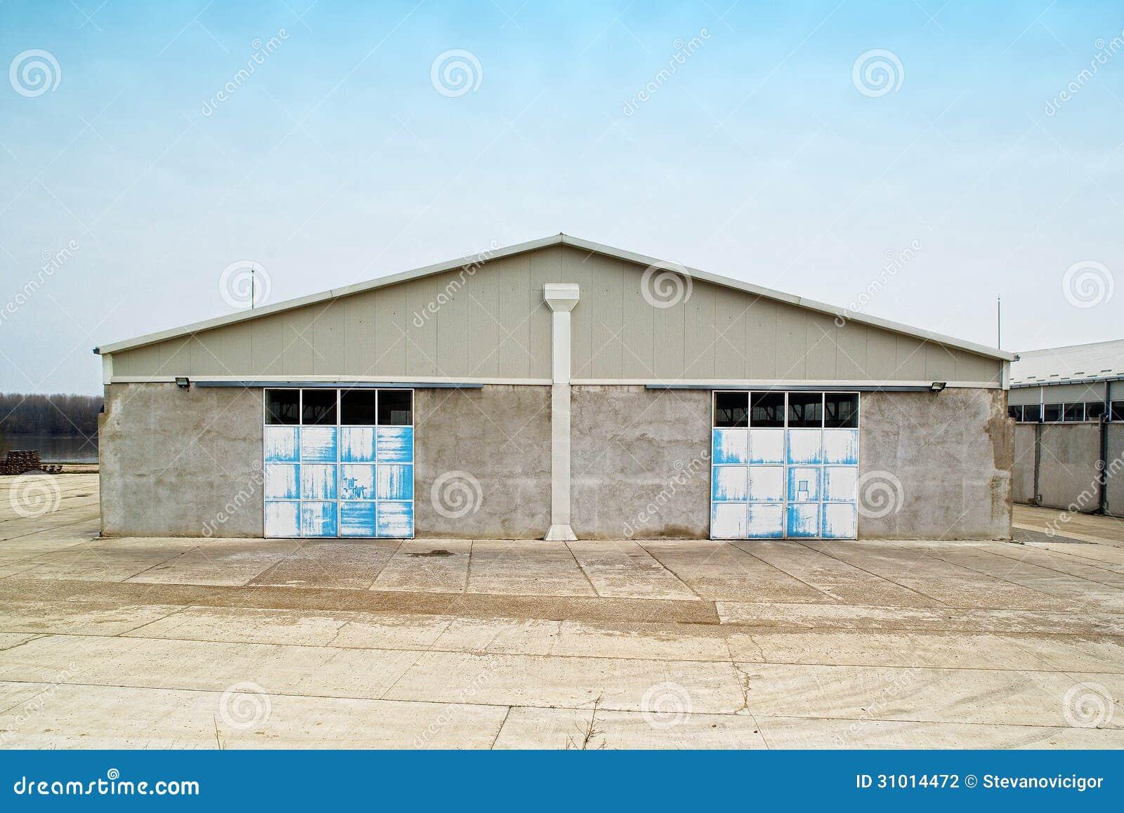 warehouse-exterior-concrete-locked-metal-door-31014472.jpg