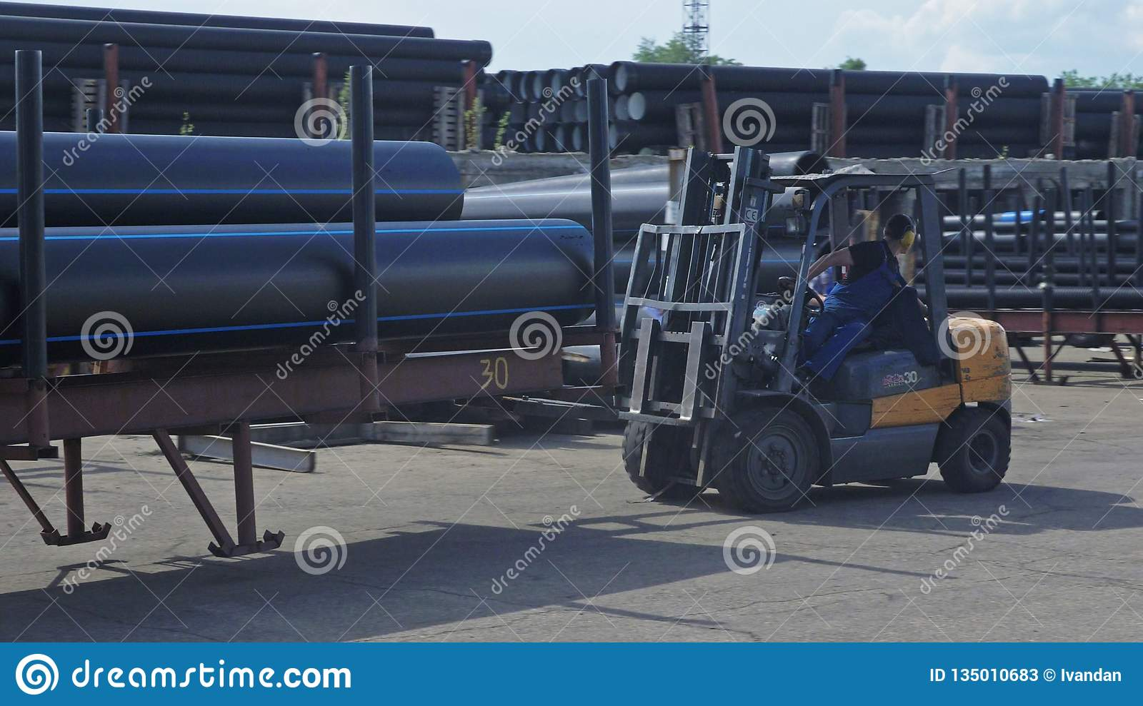 Warehouse of finished plastic pipes industrial outdoors storage site. Manufacture of plastic water pipes factory.