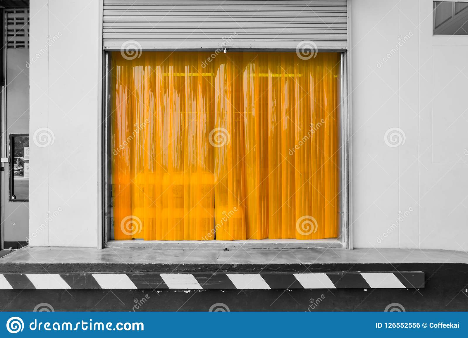 Warehouse gate loading area with PVC strip curtain