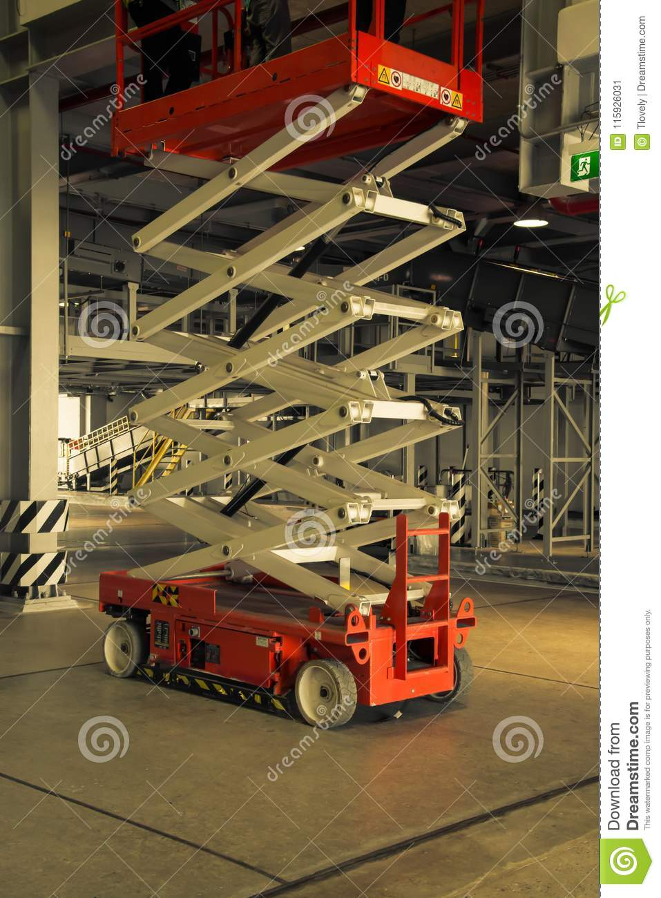 Warehouse Hall With Hydraulic Scissors Lift Stock Image