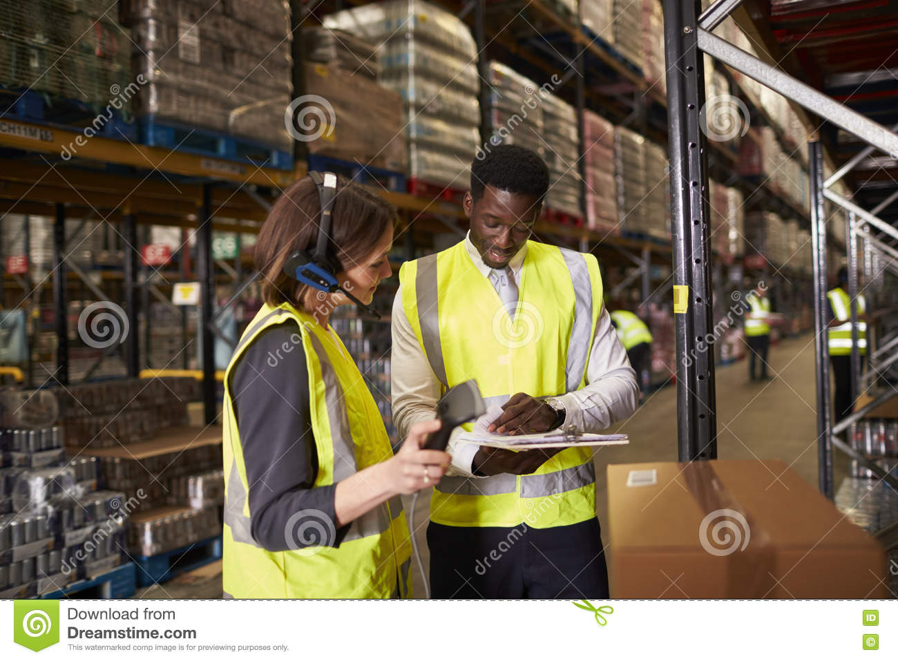 Warehouse manager talking with woman using barcode reader