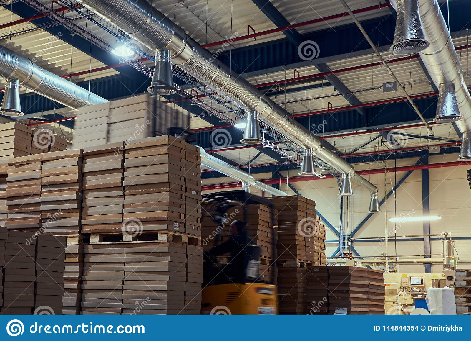 Warehouse manufacturing products for industrial use from paper and cardboard