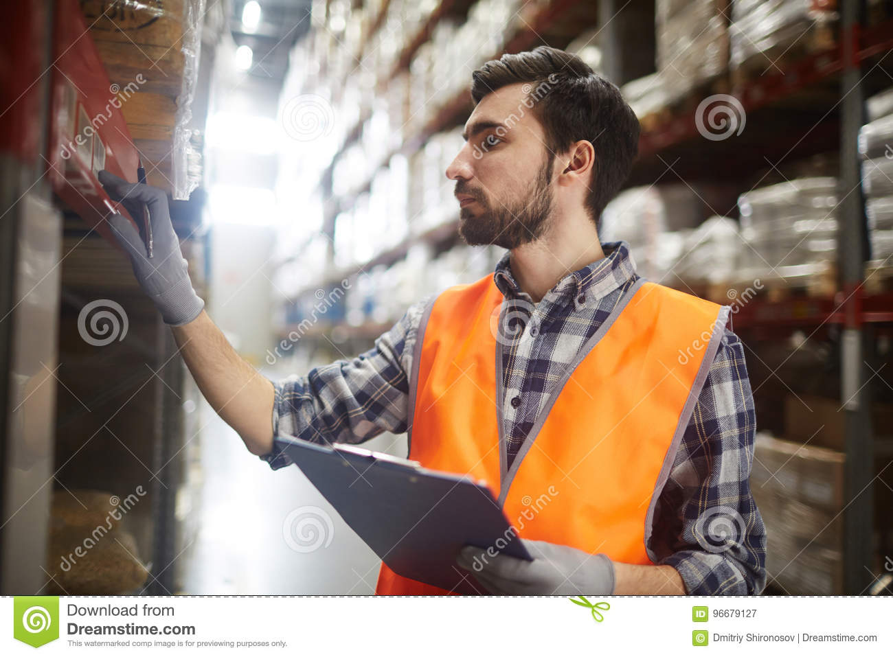 Warehouse worker reviewing goods