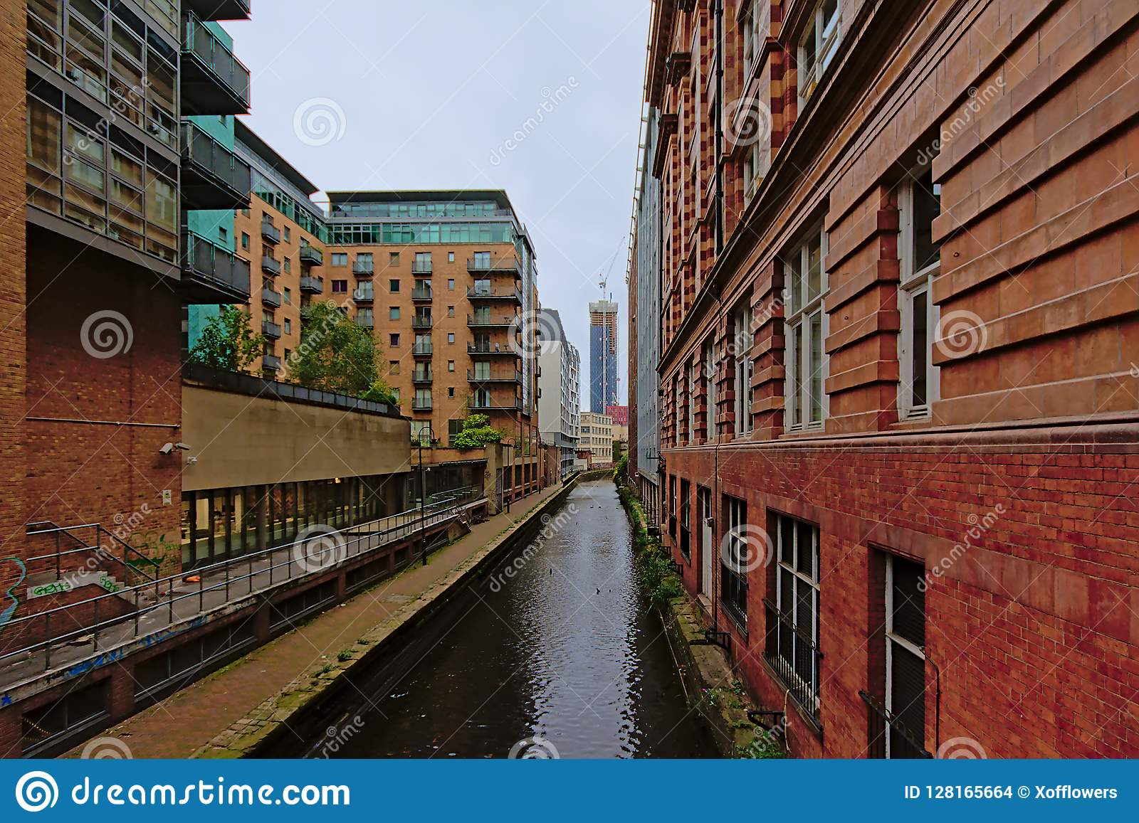 Warehouses and apartment buildings along a canal in Manchester
