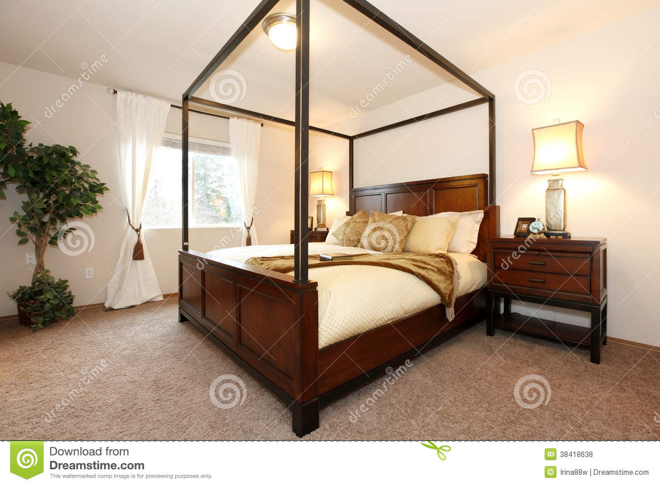 Warm Beautiful Bedroom With A High Posts Bed Royalty Free Stock