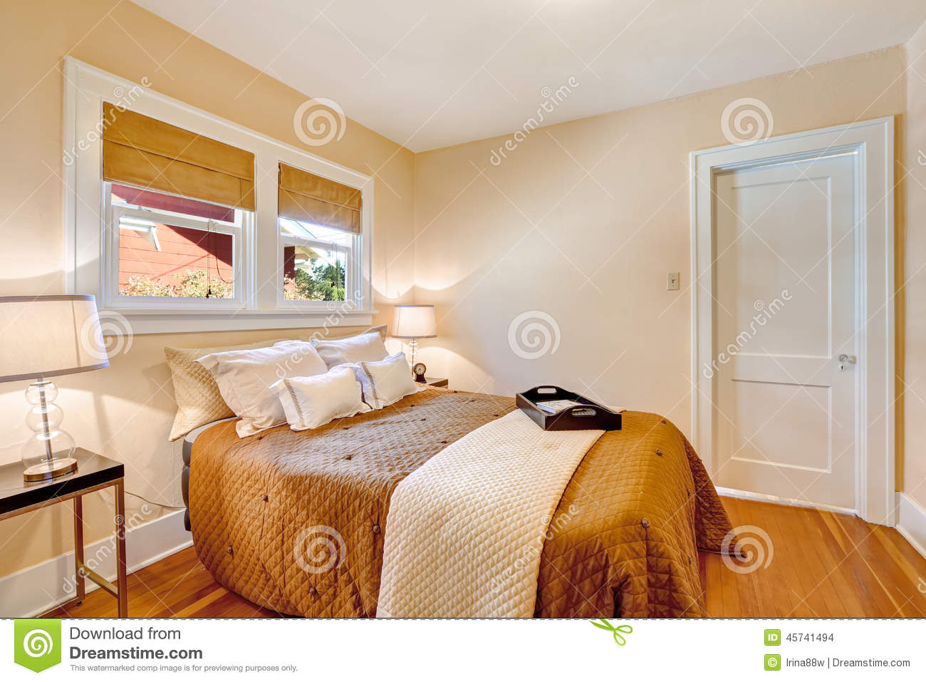 warm bedroom interior with brown bedding and ivory blanket stock photo