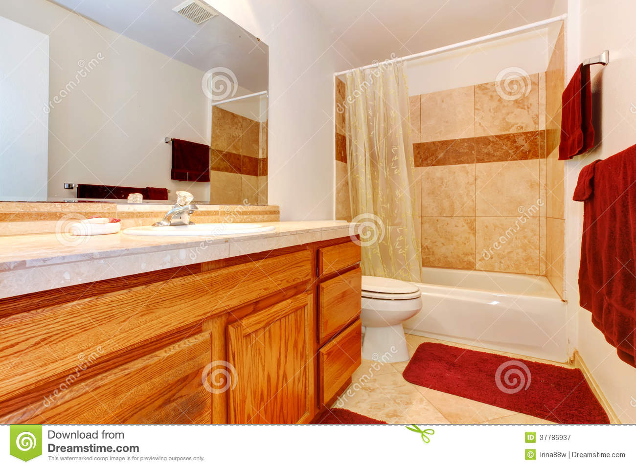 Warm Colors Bathroom With Red Towels And Rug Royalty Free