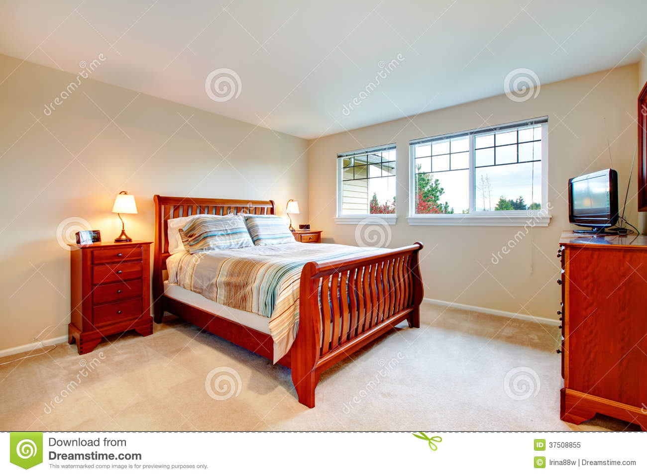warm colors bedroom with wood furniture royalty free stock