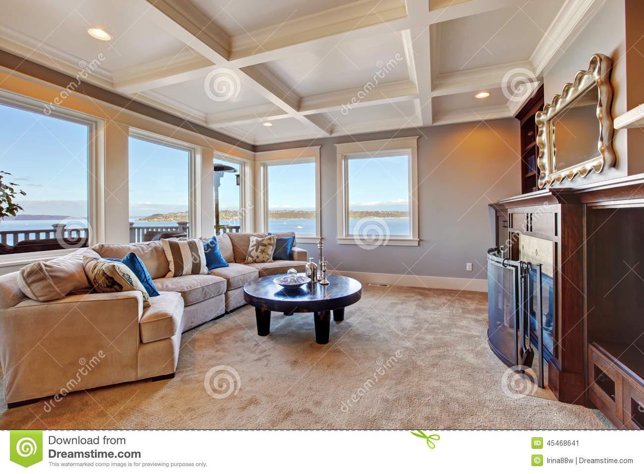 Warm living room interior in luxury house with puget sound view