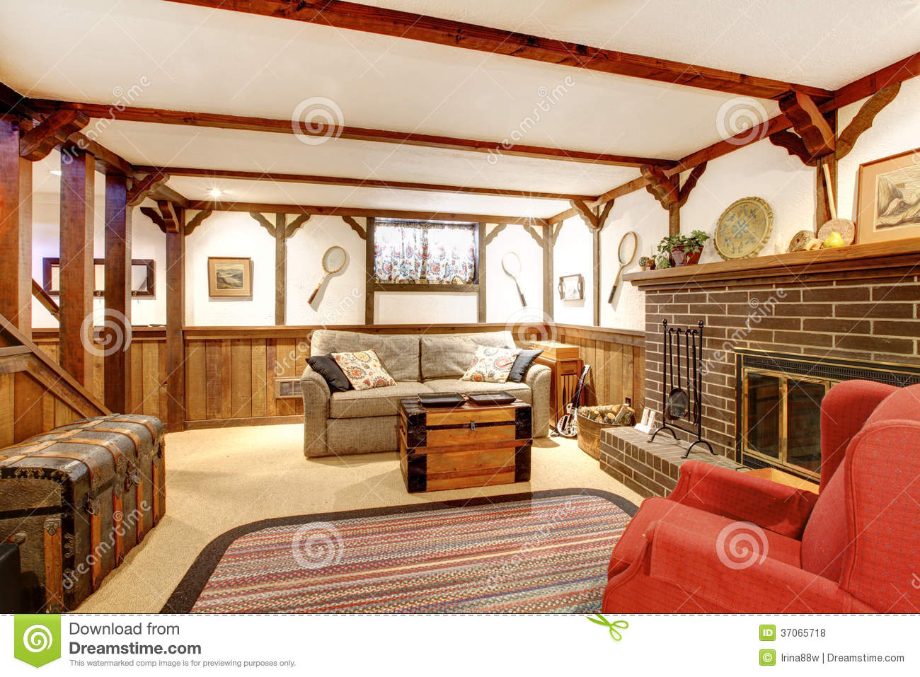 Warm Rustic Furnished Living Room With A Fireplace Stock