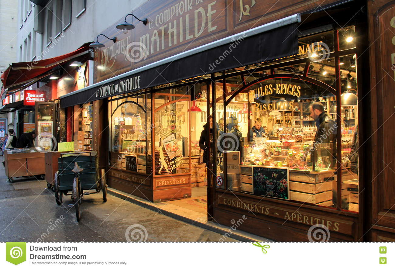 warm scene of candy storefront le comptoir de mathilde paris france 2016 editorial image. Black Bedroom Furniture Sets. Home Design Ideas