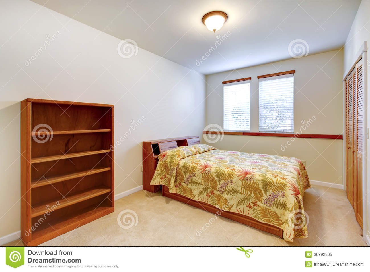 Warm simple bedroom with wooden furniture stock image for Dormitorio simple