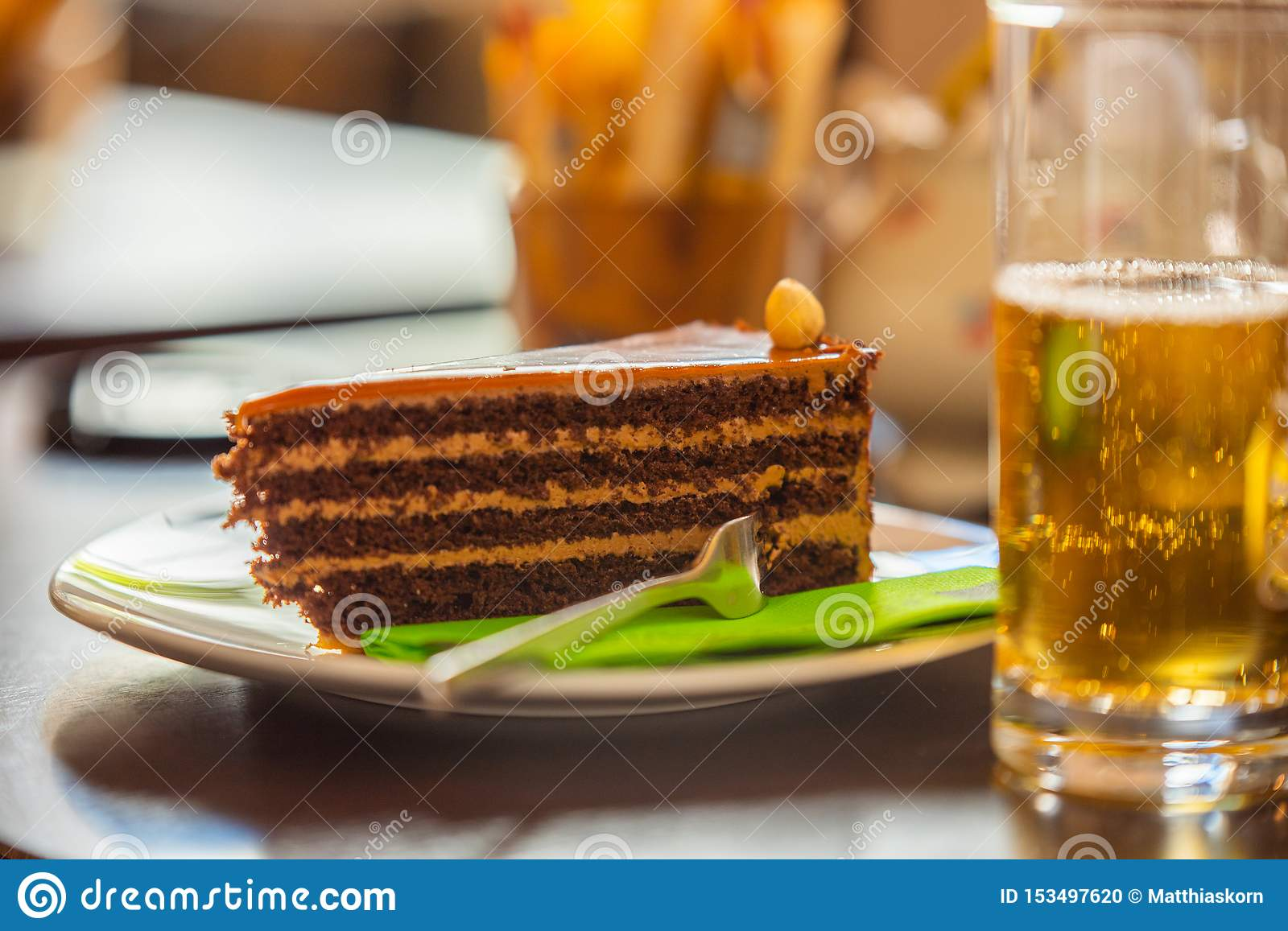 On a warm summer`s day a piece of delicious cake and a cool drink