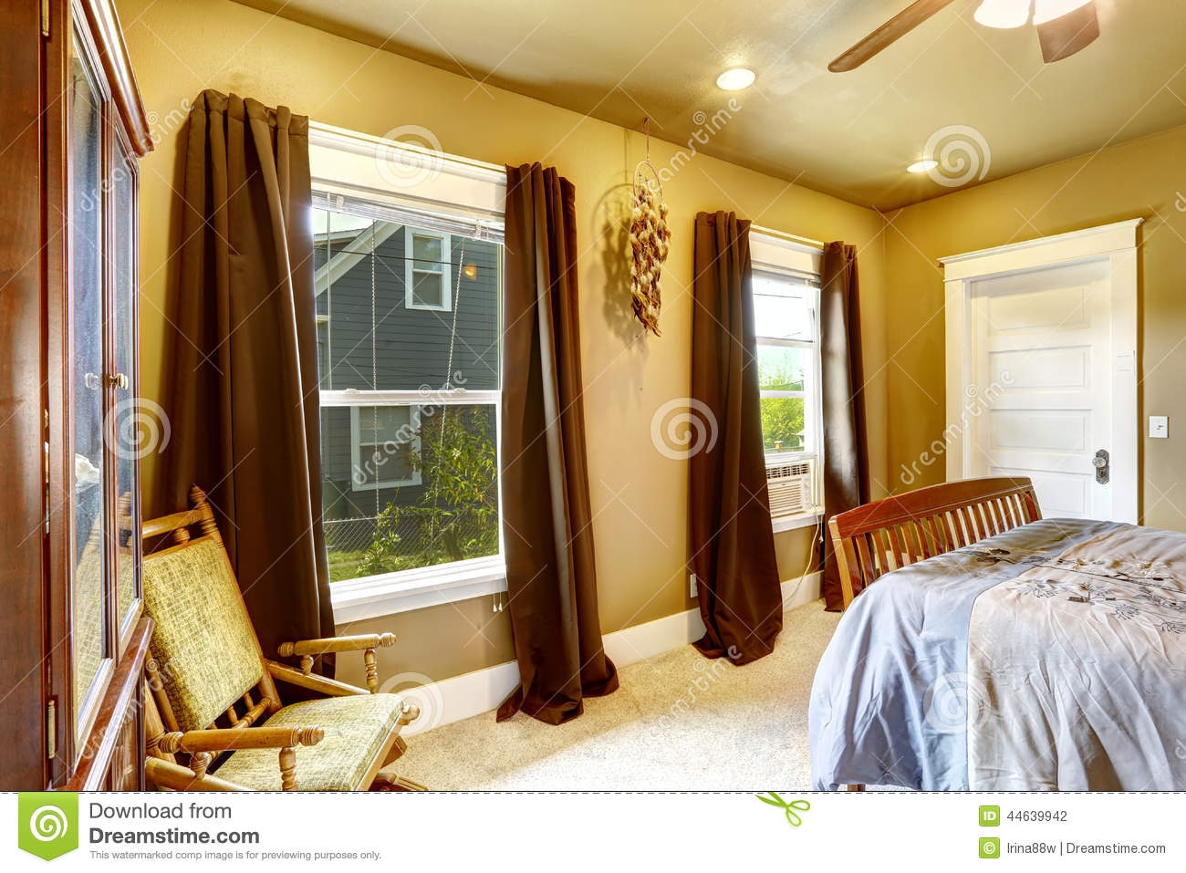 Warm tones bedroom with brown curtains stock photo image for Brown and yellow walls